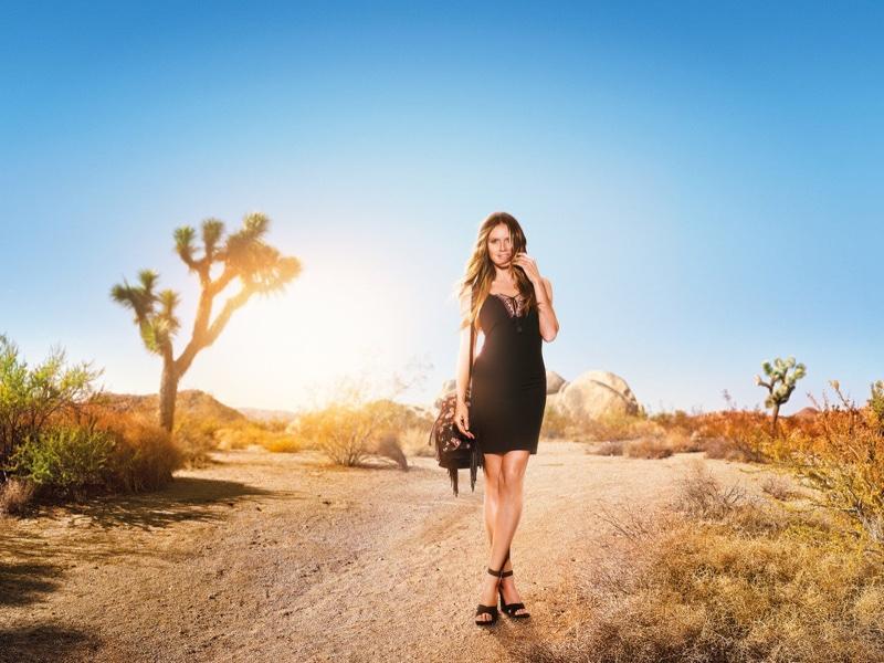 Supermodel Heidi Klum wears little black dress for Lidl campaign