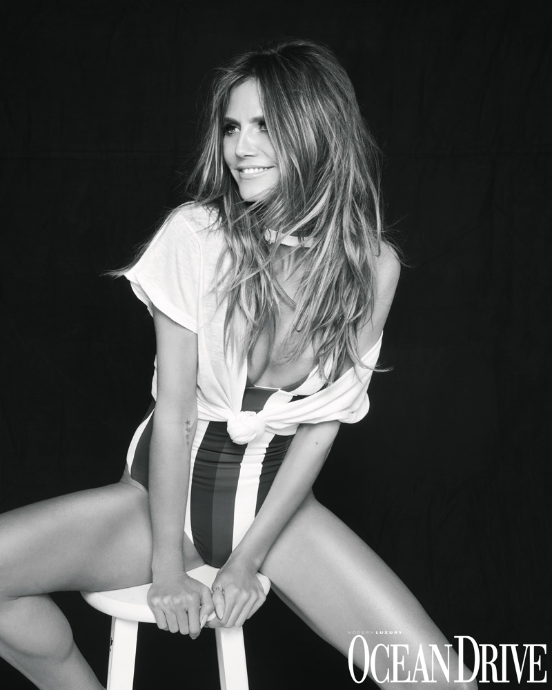 Supermodel Heidi Klum wears a Heidi Klum Swim one-piece and stylist's own t-shirt