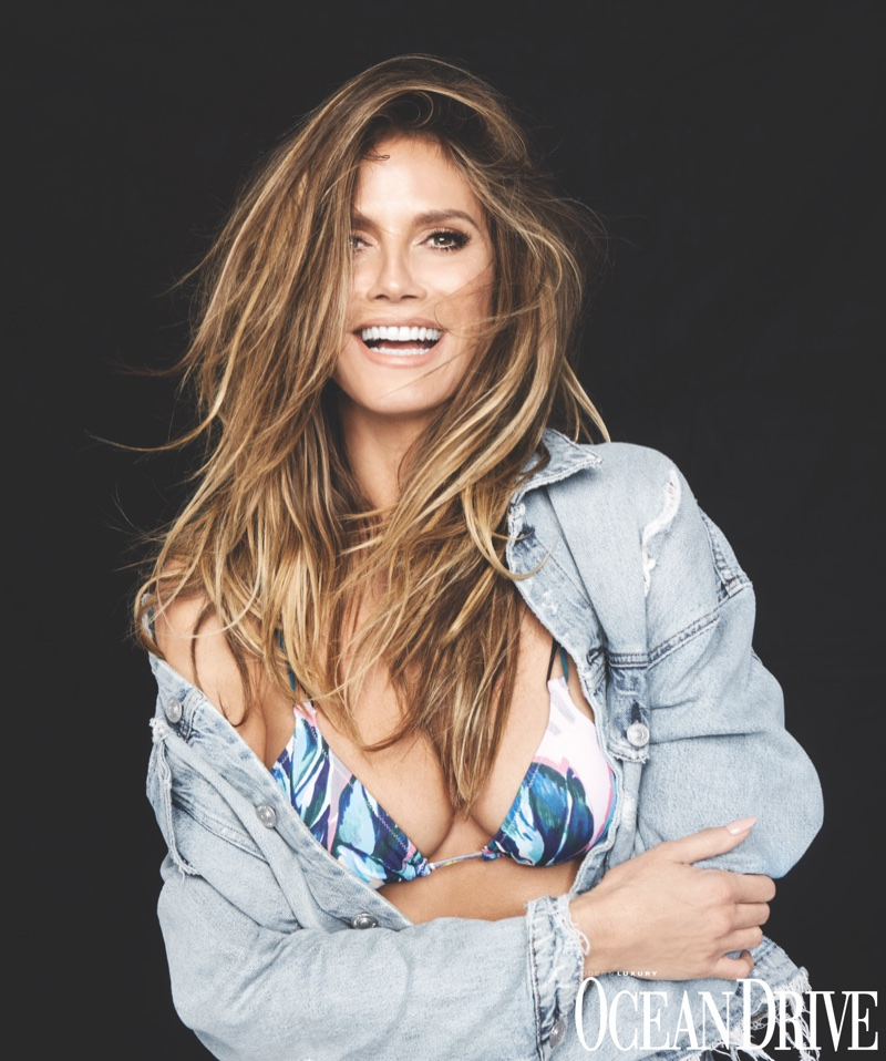 Flashing a smile, Heidi Klum wears Hudson jeans jacket and Heidi Klum Swim bikini set