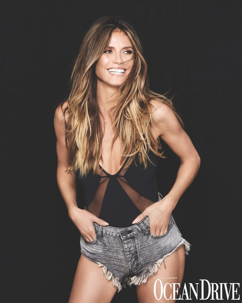 Supermodel Heidi Klum poses in Heidi Klum Swim one-piece and One Teaspoon denim shorts