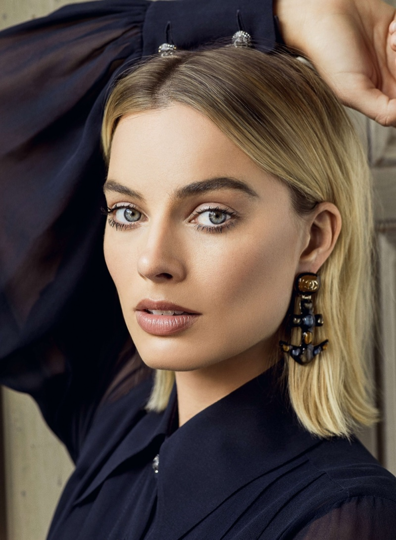 Ready for her closeup, Margot Robbie wears Chanel blouse and earrings