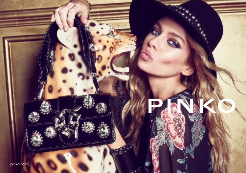 Stella Maxwell poses with a leopard in Pinko fall-winter 2018 campaign