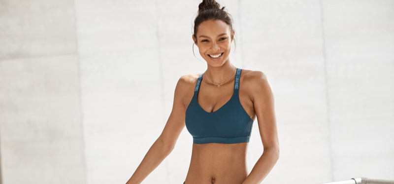 Lais Ribeiro flashes a smile in Victoria Sport Summer 2018 campaign