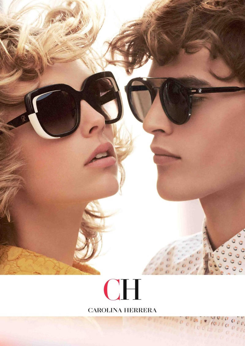 Edie Campbell and Parker van Noord wear sunglasses in Carolina Herrera fall-winter 2018 campaign