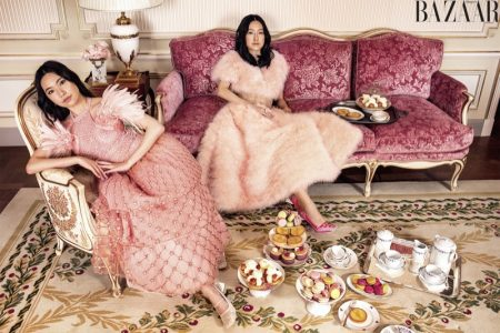 Rachel and Michelle Yeoh pose in Fendi Couture dresses and shoes with Cartier jewelry