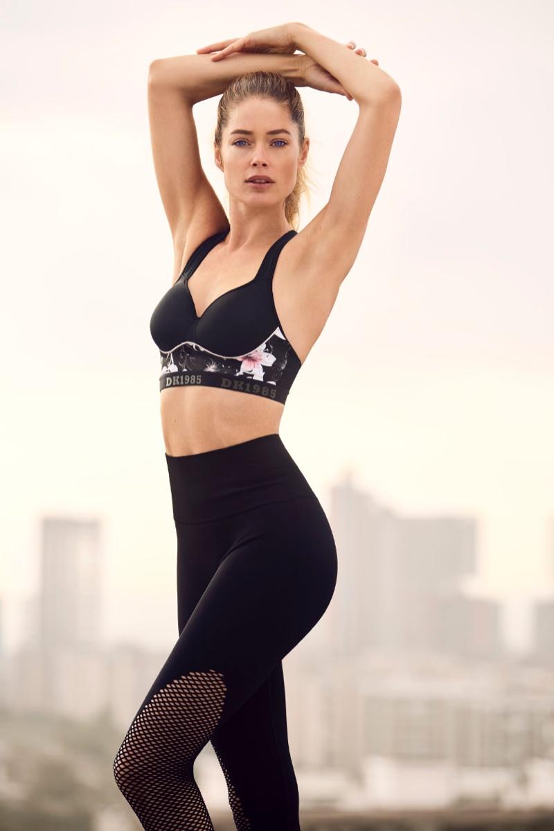 Wearing her activewear collaboration, Doutzen Kroes fronts Hunkemoller DK 1985 campaign