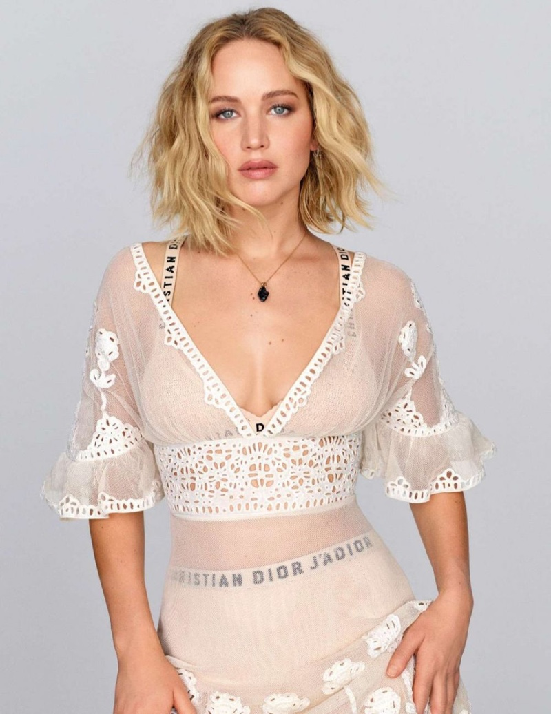 Actress Jennifer Lawrence poses in Dior dress and undergarments