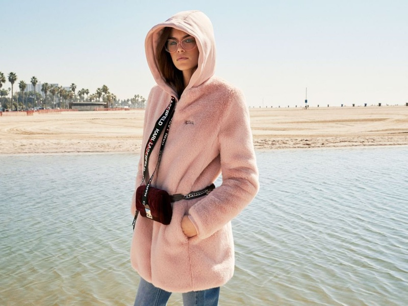 Kaia Gerber wears pink hooded jacket from the Karl Lagerfeld x Kaia Gerber capsule collection