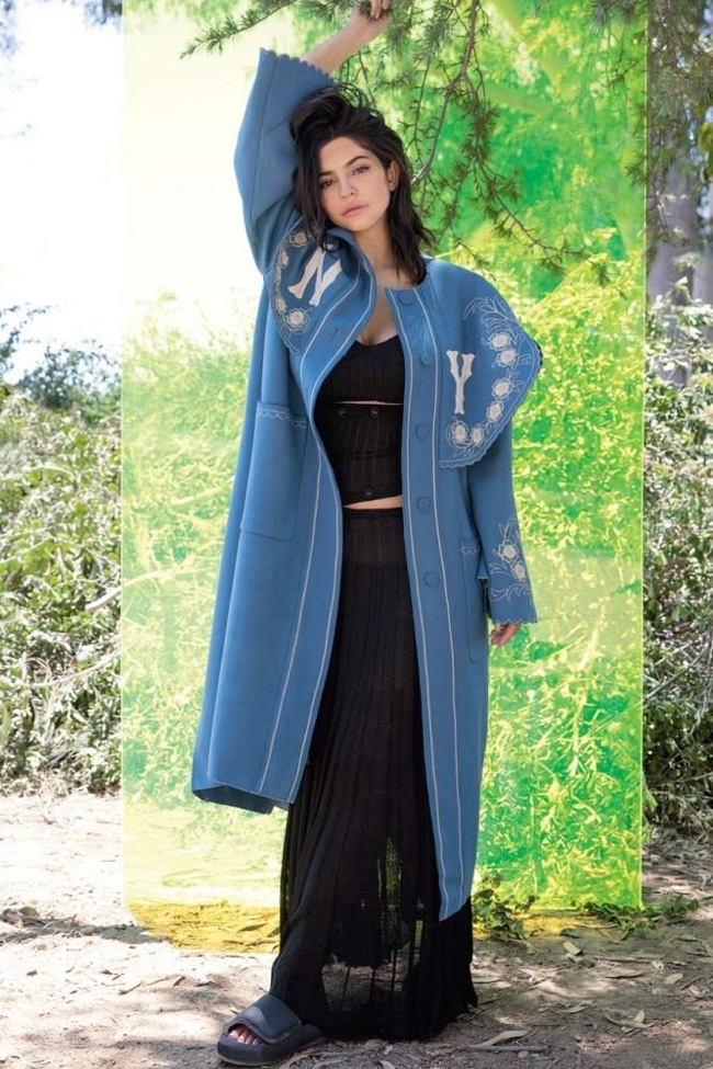 Kylie Jenner poses in Gucci coat
