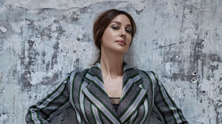 Striking a pose, Monica Bellucci wears Emporio Armani dress and Eres bodysuit
