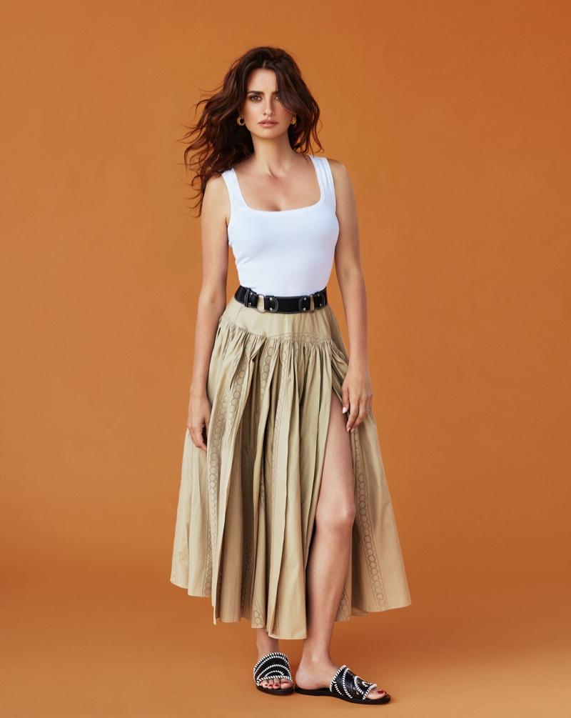 Actress Penelope Cruz wears Azzedine Alaia bodysuit, belt, skirt and sandals with Celine earrings
