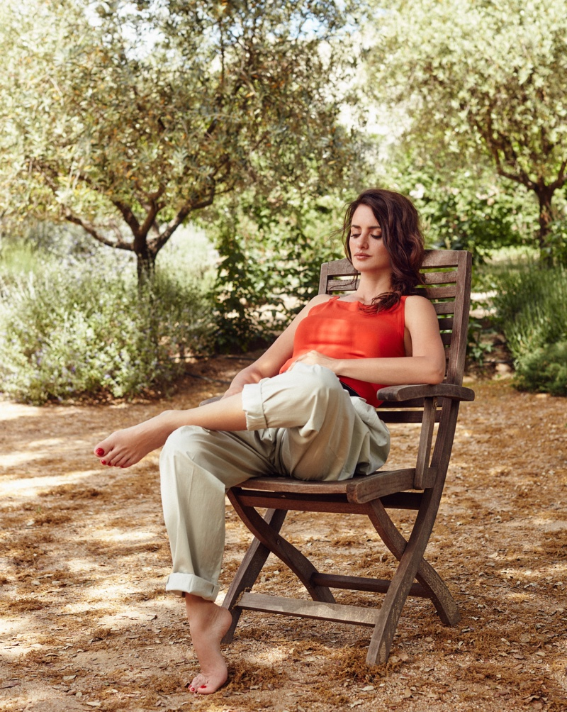 Lounging in style, Penelope Cruz poses in Azzedine Alaia bodysuit and Nina Ricci pants