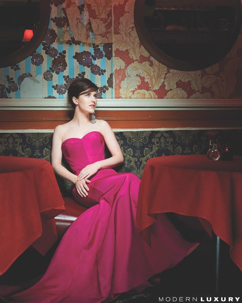 Rachel Brosnahan poses in Zac Posen gown and Tom Ford earrings