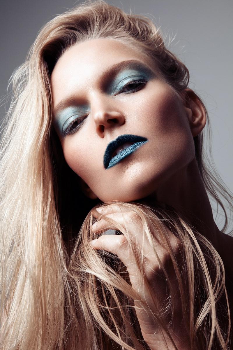 Sarah DeAnna shows off bold eyeshadow and lipstick. Photo: Jeff Tse