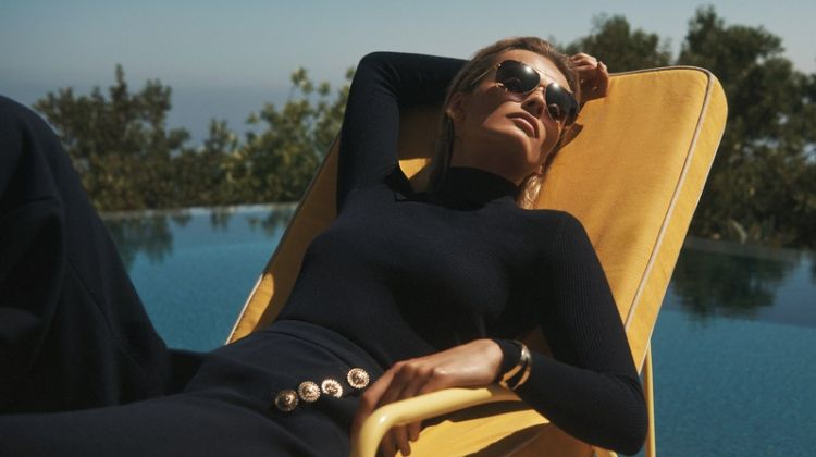Edita Vilkeviciute lounges by the pool for St. John fall-winter 2018 campaign