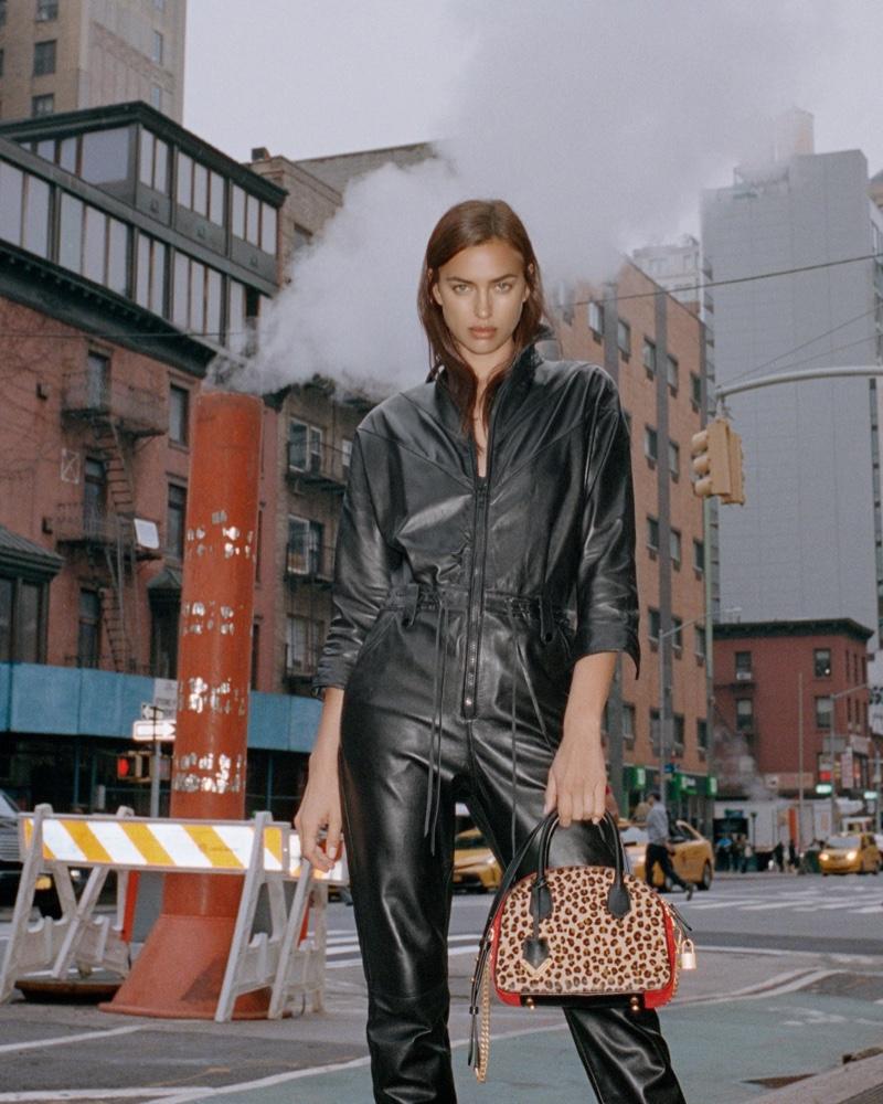 Model Irina Shayk poses with the Irina bag from The Kooples