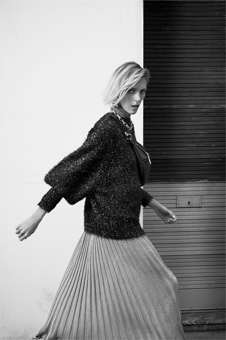 Zara features metallic sweater and pleated skirt