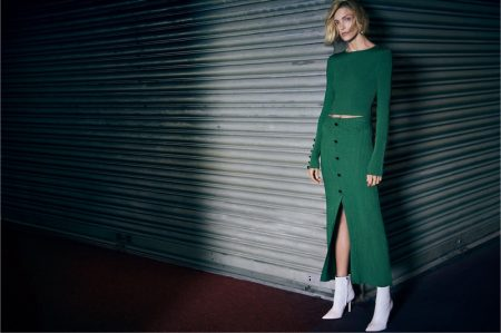 Anja Rubik models Zara green ribbed top and skirt with white ankle boots