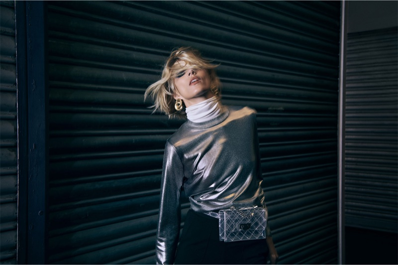 Anja Rubik poses in Zara metallic top, white turtleneck and knitted trousers with vinyl belt bag