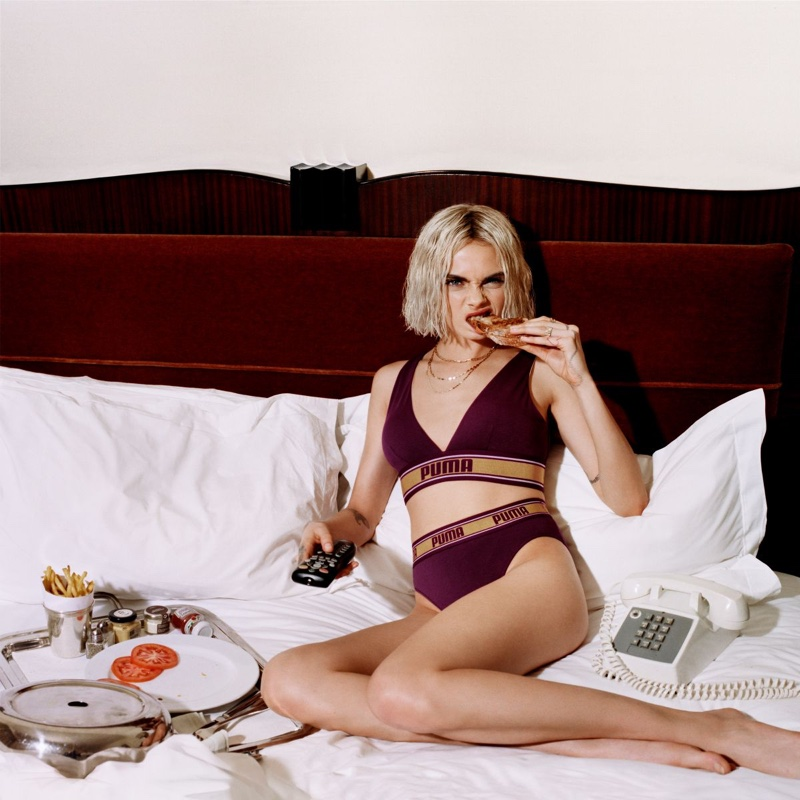 Posing in bed, Cara Delevingne eats for PUMA Bodywear campaign