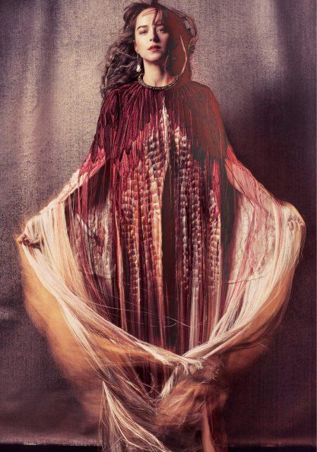 Actress Dakota Johnson wears Alexander McQueen cape, antique earring and choker necklace