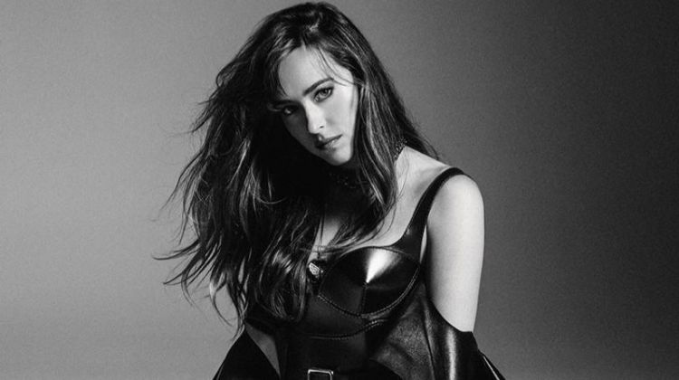 Photographed in black and white, Dakota Johnson wears ruffled dress