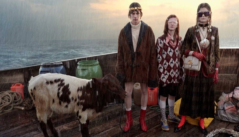Models pose in the rain for Gucci cruise 2019 campaign