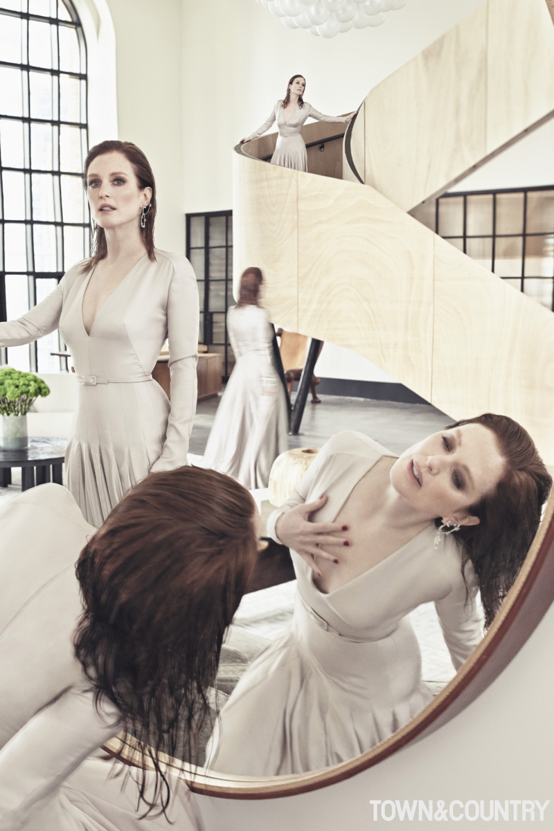 Actress Julianne Moore poses in Dior Haute Couture dress with Ana Khouri earrings