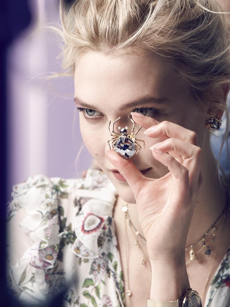 Karlie Kloss shows off a spider pendant on set of Swarovski winter 2018 shoot