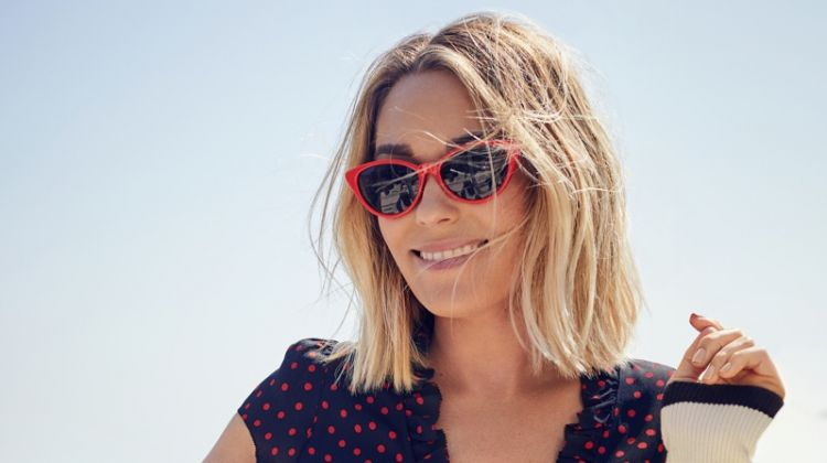 Designer Lauren Conrad poses in Rouje dress, Navy Days cardigan and LC Lauren Conrad Sunglasses