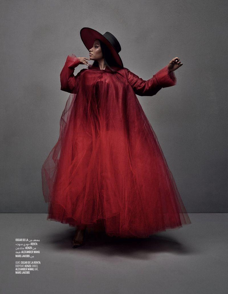 Striking a pose, Nicki Minaj wears Oscar de la Renta coat, Kenzo bodysuit, Alexander Wang shoes and Marc Jacobs hat