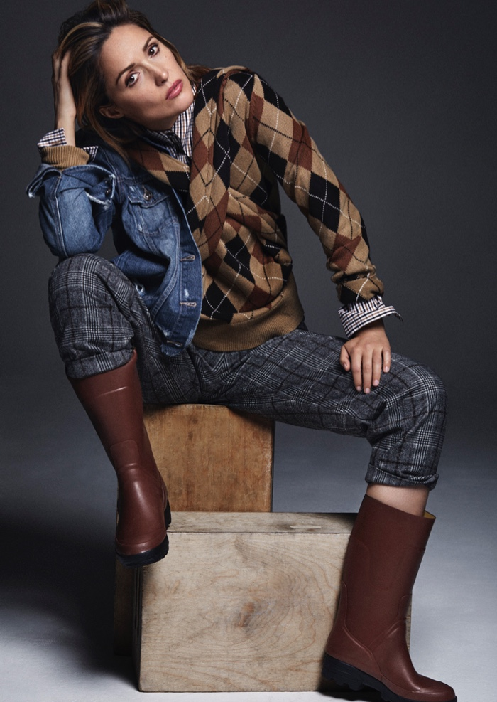 Actress Rose Byrne wears Michael Kors shirt and sweater, Brunello Cucinelli trousers, Paige jacket and Lacoste x Aigle boots