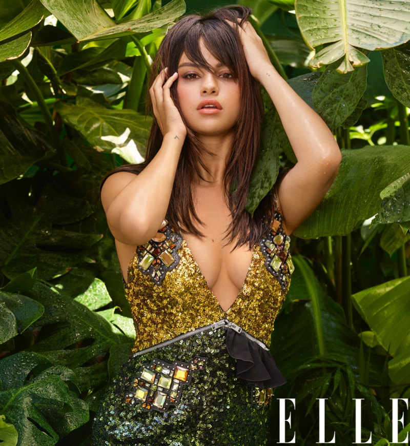 Turning up the shine factor, Selena Gomez Poses in sequin and crystal adorned Coach dress