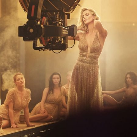 BEHIND THE SCENES: Charlize Theron shines in gold dress for Dior J'adore Absolu fragrance shoot