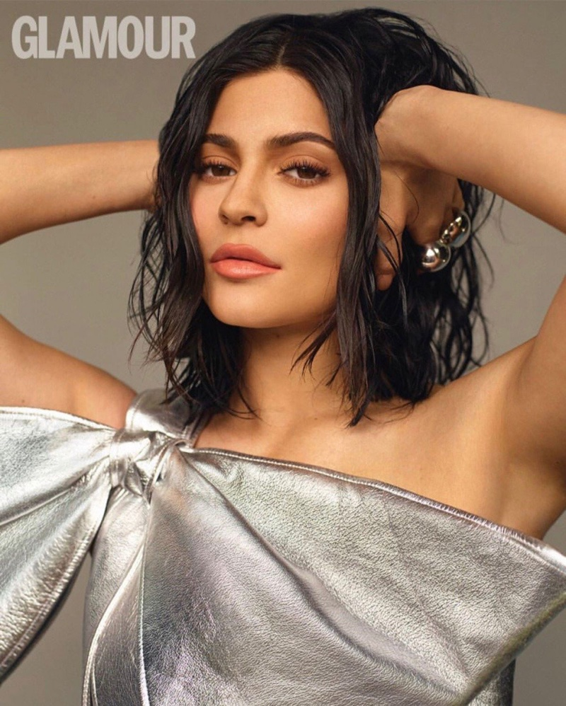 Turning up the shine factor, Kylie Jenner poses in silver Christian Cowan dress