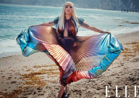 Posing on the beach, Lady Gaga wears pleated and multicolored dress