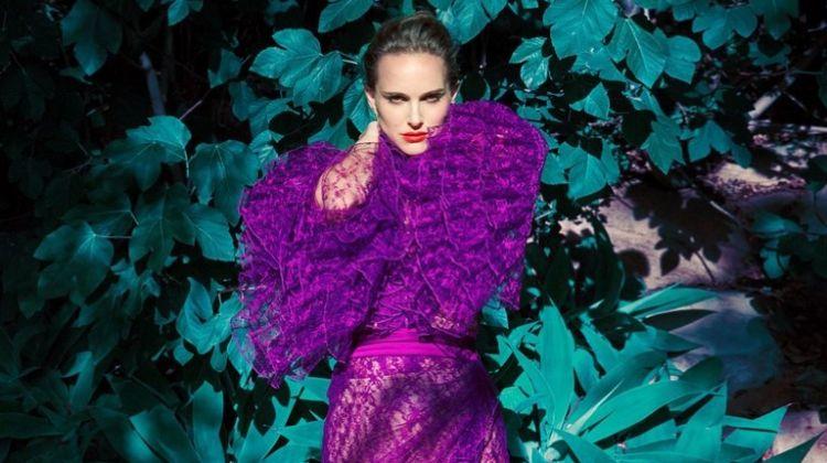 Actress Natalie Portman poses in a purple Rodate dress
