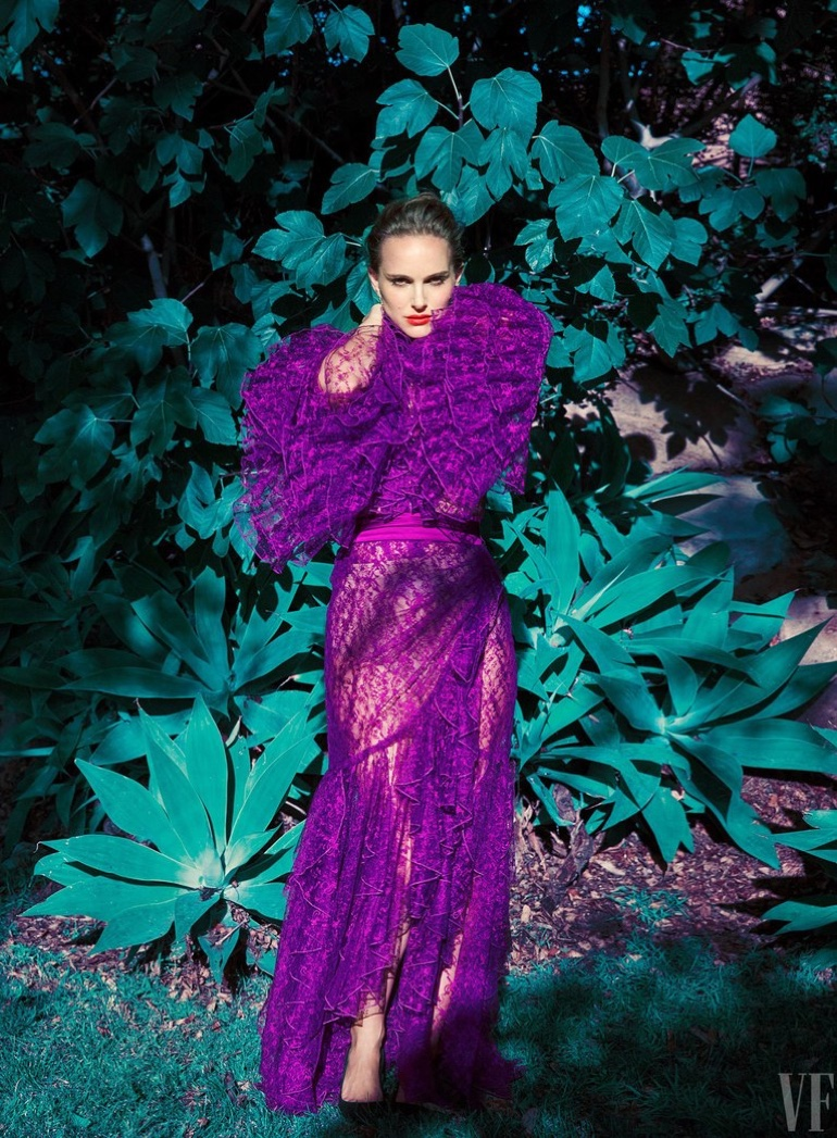 Actress Natalie Portman poses in a purple Rodarte dress