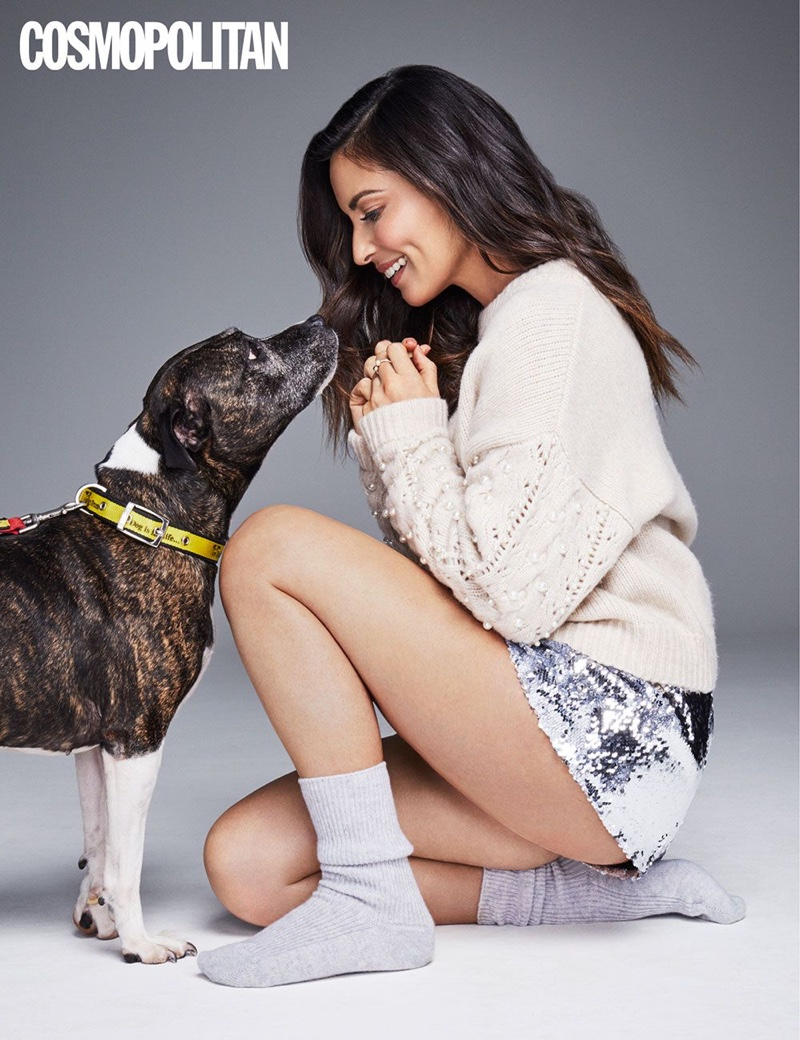 Wearing a sweater and sequin shorts, Olivia Munn looks comfortable