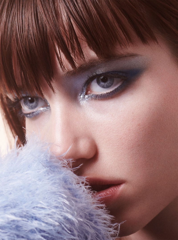 Grace Hartzel models a glittery eye makeup look