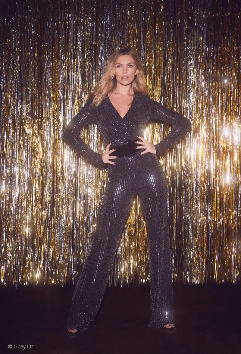 Striking a pose, Abbey Clancy wears Lipsy London glitter jumpsuit