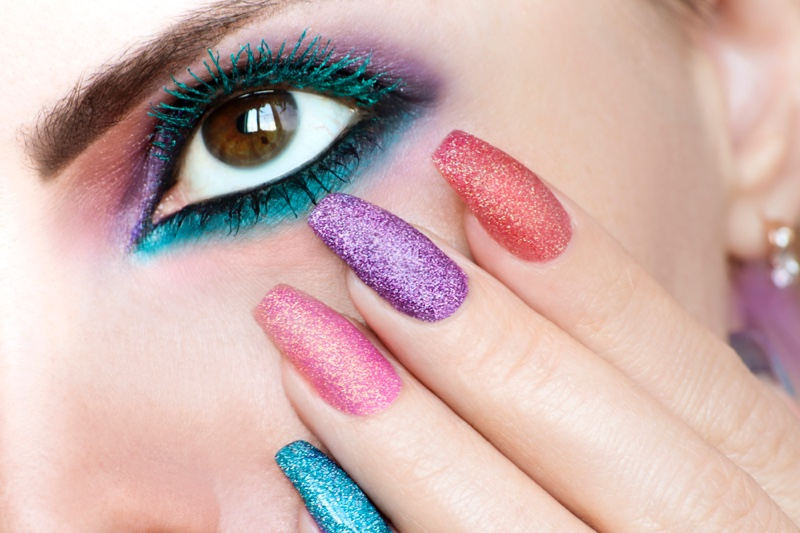 Colored mascara channels a retro inspired look.