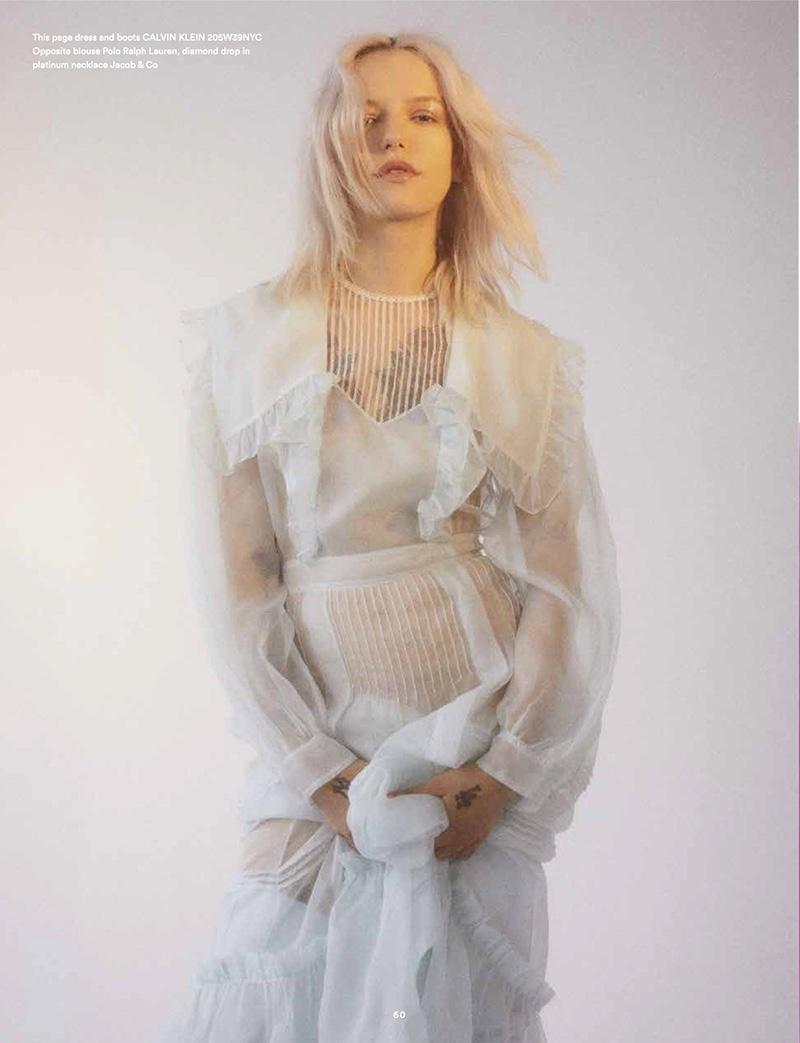 Dressed in white, Bria Vinaite poses in Calvin Klein dress