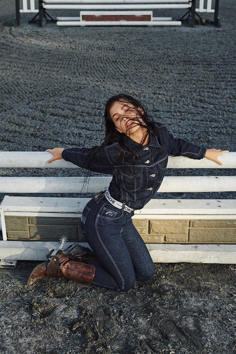 Posing at a farm, Camila Morrone wears Jordache's denim styles
