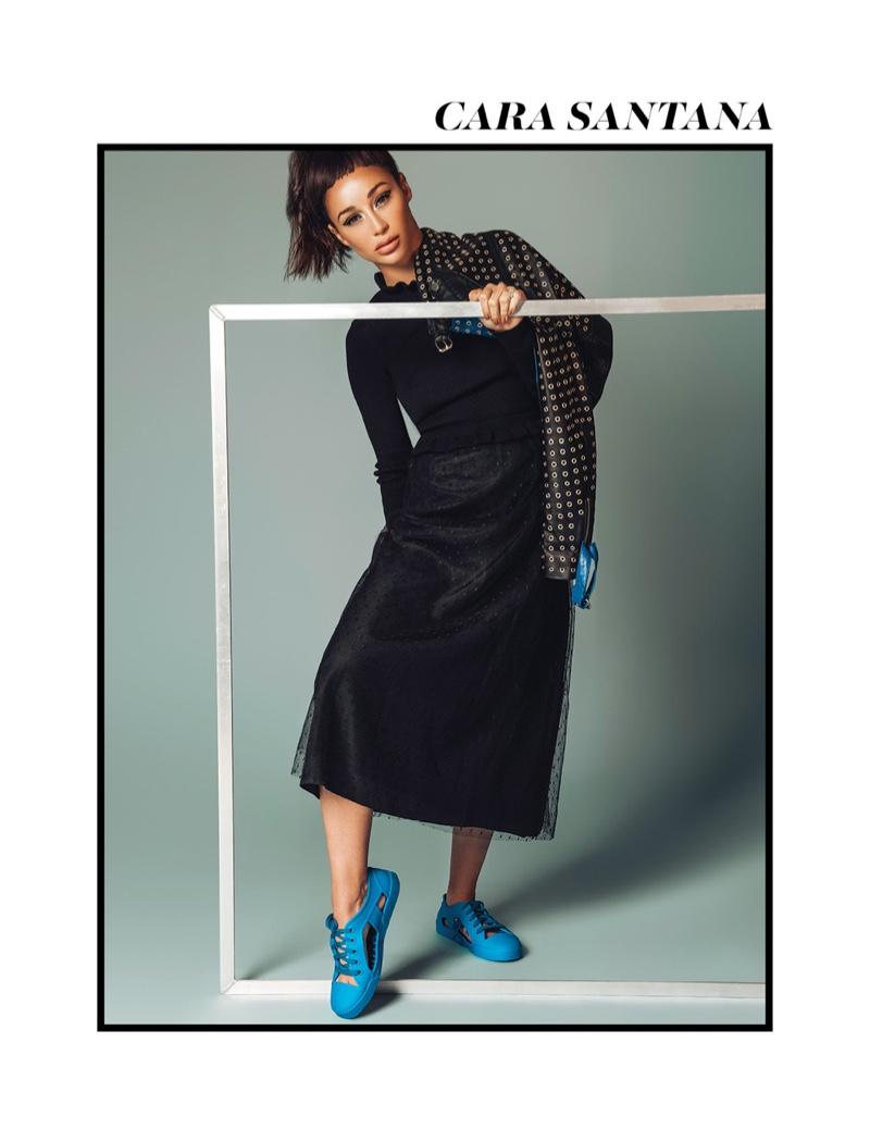 Clad in black, Cara Santana wears a sporty look