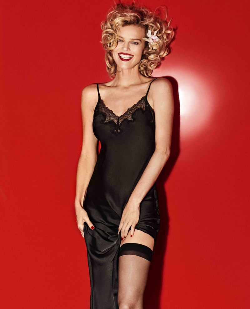 Supermodel Eva Herzigova poses in a black slip dress from Yamamay
