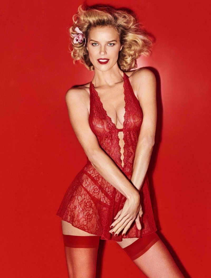Eva Herzigova models a red-hot lace ensemble from Yamamay Lingerie