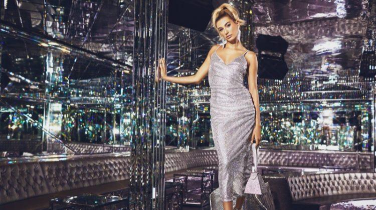 Model Hailey Baldwin wears PrettyLittleThing Silver Sequin Wrap Over Midaxi Dress $75
