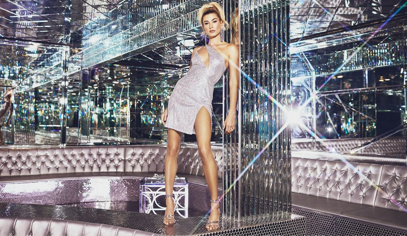 Hailey Baldwin poses in PrettyLittleThing Silver Sequin One Shoulder Cut Out Bodycon Dress $45