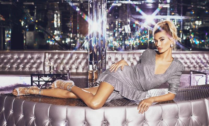 Hailey Baldwin wears PrettyLittleThing Silver Puff Sleeve Frill Hem Wrap Dress $45